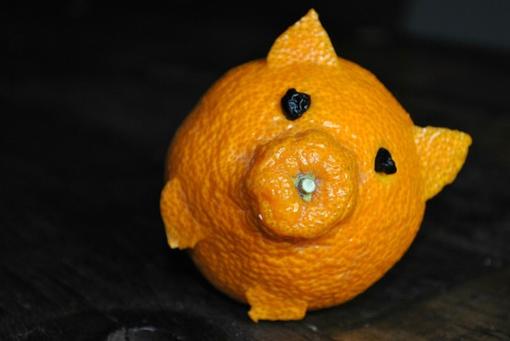 tangerine-pig-falls-over